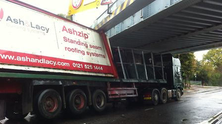 The lorry hit Fairlop Bridge at about 8.25am
