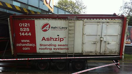 The lorry has become wedged under the bridge