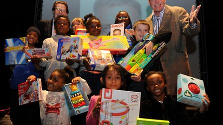 Suggs with children from The Rokeby Community Links Centre and Loreen Phillip, Stratfrod Community E