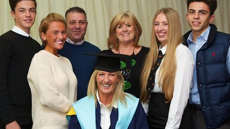 Samantha Thomas, who received a BA (Hons) in social work and her family, including daughters Nadine