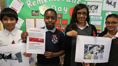 Adan Jamal 10, Darnell Salaam 10, Neela Begum 10 and Dua Ahmed 11 with some of their work from the s