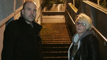 Tom McLaren and Emma Best on the steps at the footbridge