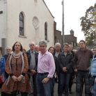 Protesters gathered outside the church on Saturday
