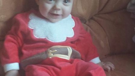 Danny McKnight from Barkingside, aged 10 months, rocking his Father Christmas outfit