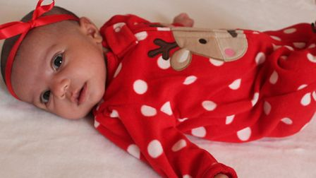 Six week old Saloni Bhogal, from Ilford looking cute in her reindeer themes Christmas outfit