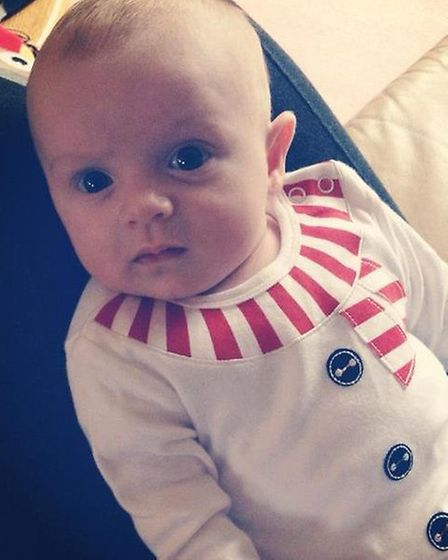 Lorna Florence, pictured at nine weeks old from Wanstead, in her candy cane themed outfit