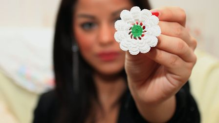 Monomita holds the Srebrenica flower, a symbol of the victims from the genocide in Bosnia