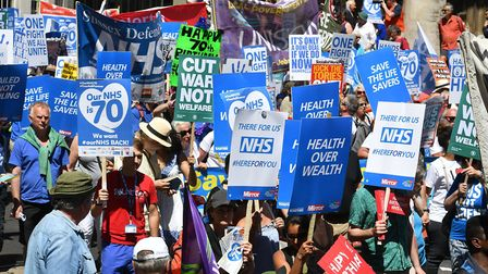 People marching to celebrate the 70th anniversary of the NHS. Picture: John Stillwell/PA