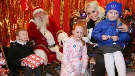 Santa and Amelia Lily with kids in his grotto