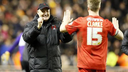 Orient boss Russell Slade and his captain Nathan Clarke have had a lot to smile about this year. Pic