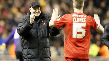 O's boss Russell Slade celebrates with Nathan Clarke after the win at Gillingham. Simon O'Connor