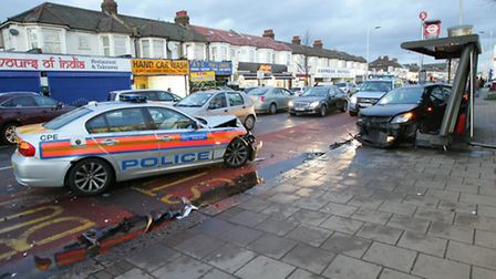 The black Vauxhall Astra slammed into a bus stop