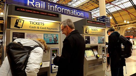 Commuters buy train tickets at Victoria station (John Stillwell/PA Wire)