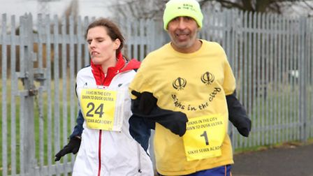Harmander Singh running with Louise Simpson, a Paralympian Goalballer. Mr Singh will run his 30th Lo