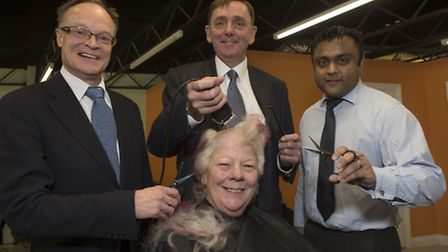 Councillor Sheila Thomas underwent the headshave with help from Sir Robin Wales and fellow councillo