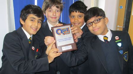 Niam Prisaca, Danielius Samsonov, Adil Choudhury and Uzair Syed-Muhammad with their trophy.
