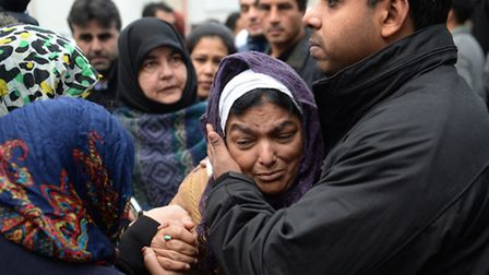 Fatima Khan, mother of Dr Abbas Khan 32, who died while being held in custody in Syria, is comforted