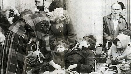 Diana Princess of Wales with youngsters at Barnardo's in Barkingside during a visit to the headquart