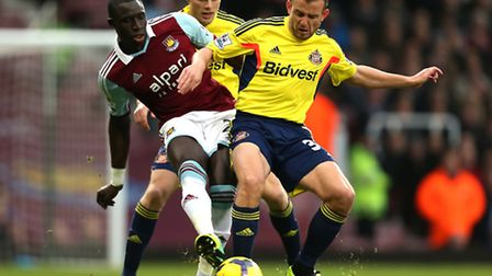 West Ham United's Mohamed Diame (left) competes for the ball with Sunderland's Sebastian Larsson (centre) and Lee...