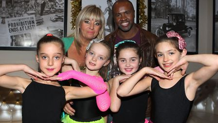 Colin Mcmillan, with Avril Mills and dancers at the party