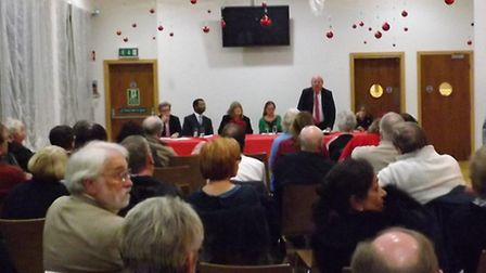 The crowd watches Ilford South MP Mike Gapes speak at a public meeting on the future of King George