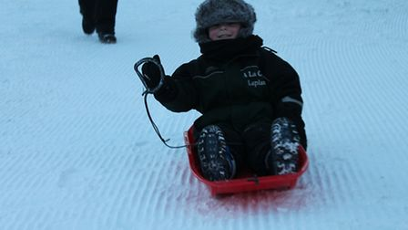 Oliver Morgan on a toboggan in Lapland after having his wish granted by Make-A-Wish Foundation