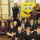 Brentwood Preparatory School pupils with Spongebob SquarePants, who was sent to the cake sale by Nic