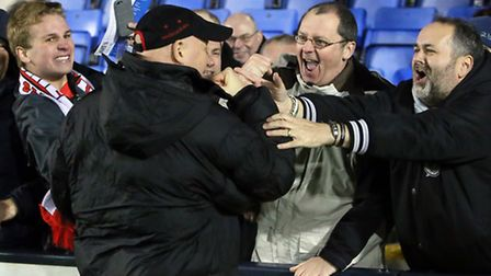 Orient boss Russell Slade celebrates with supporters after victory at Shrewsbury (pic: Simon O'Conno