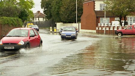 Cars manouvere through water-filled roads following the 2000 floood