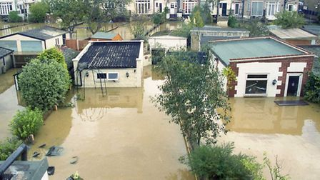 Submerged gardens in Chigwell Road after the River Roding burst its banks in October 2000