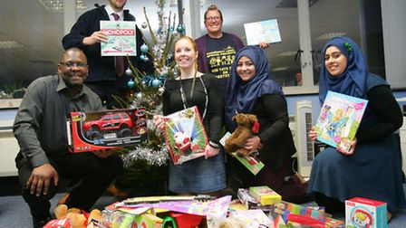 Alex Dudley with his staff and Paula Blake from Community links with the toy donation