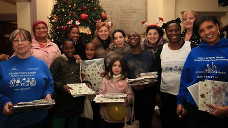 Children receive toys in a Christmas party at the Community Links centre, Canning Town.