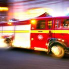 Crews from across east London are tackling the blaze at the disused warehouse