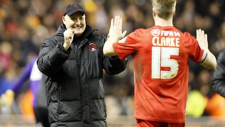 Russell Slade with Orient skipper Nathan Clarke. Simon O'Connor