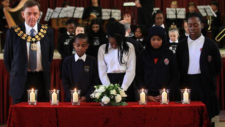 Sir Robin Wales and children keep a minute-silence at the Holocaust Memorial Day service at Newham T