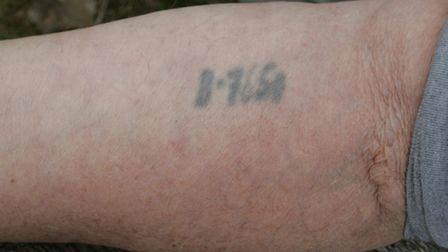 The number branded on Bob's arm.