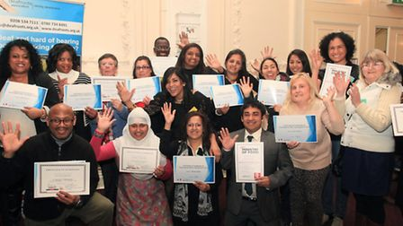 People with impaired hearing receive certificates at the Achievement Award Ceremony by Deafroots.