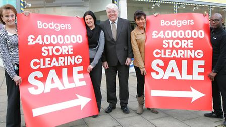 Rai Holdstock (centre) with Bodgers staff ahead of their sale