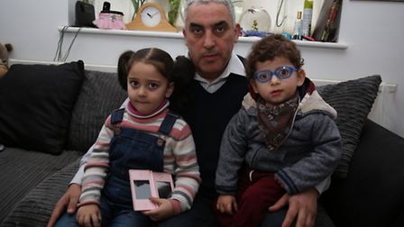 Mohamed Djitli, with his son Amine, two, and daughter Nour, four