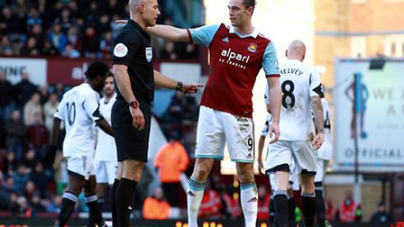 Match referee Howard Webb (left) and West Ham United's Andy Carroll during the Barclays Premier Leag