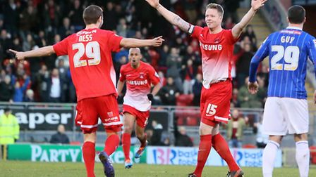 Jamie Ness celebrates a goal on his home debut with O's skipper Nathan Clarke. Pic by Simon O'Connor
