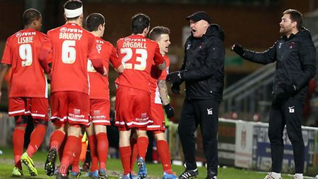 Orient players rush to celebrate with manager Russell Slade. Pic by Simon O'Connor
