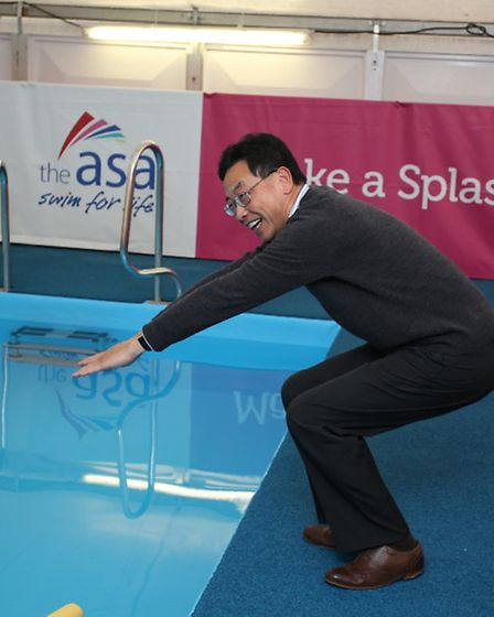 Cllr Chan prepares to dive into the new pool