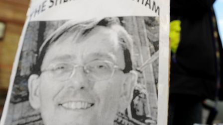 A campaigner with a poster of Newham Mayor Robin Wales