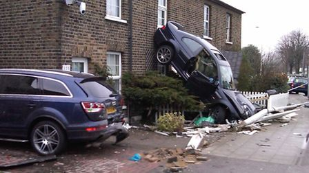 A BMW ended up resting precariously in Barley Lane in March 2010