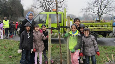 Children from South Park Primary School plant trees with charity Trees for Cities.