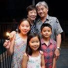 Lucy Chan (back L) with her husband and three grandchildren