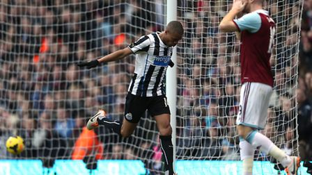 Newcastle United's Loic Remy celebrates scoring his sides second goal as West Ham United's James Col