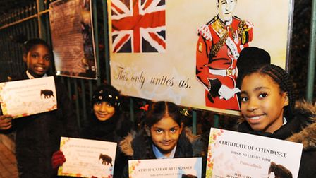 Children who helped make a Lee Rigby memorial board: (left to right) Serena Thomas, 9, Hannah Chowdh