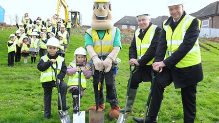 Headteacher Andy Kelly, Cllr Michael White and children at the beginning of the expansion of Branfil
